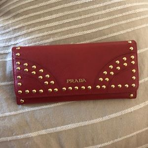 Red Prada wallet with gold accents